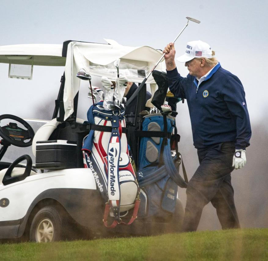 Donald Trump relaxes in his own golf club on the weekend instead of ruling