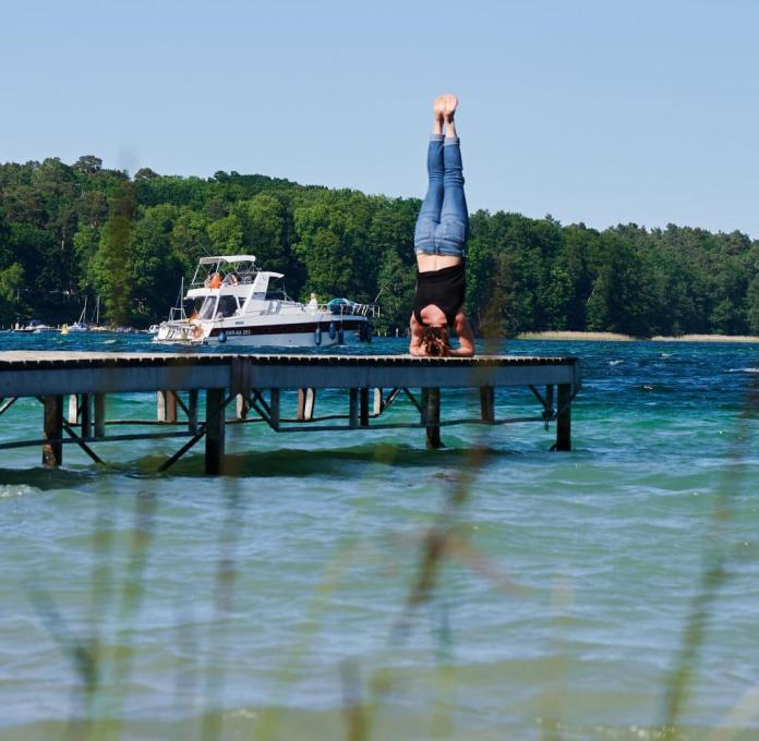Yoga by the lake: people like to take big city habits to the countryside