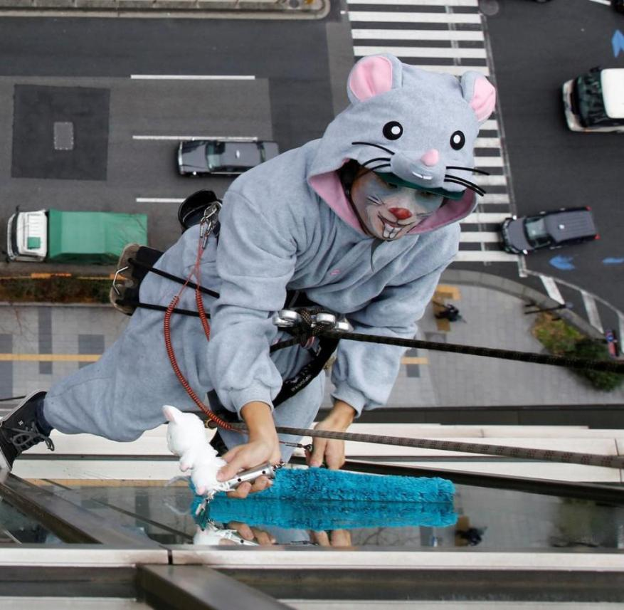 Japan: Even adults like to dress up as mascots, even at work