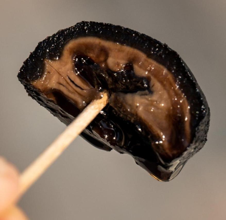 Larnaka in Cyprus: sweet walnut snack on a toothpick
