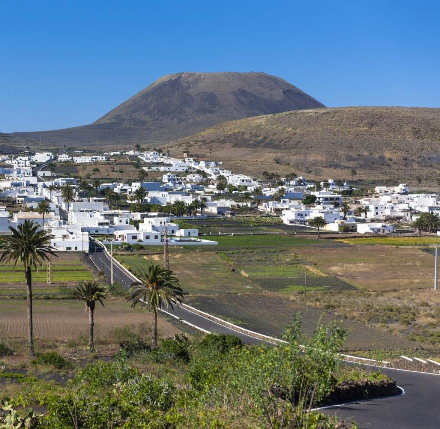 Canary Islands (Spain): The volcano in the background that towers over Lanzarote is called Monte Corona of all places