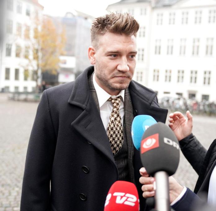 Nicklas Bendtner turns to the media after leaving the courthouse in Copenhagen
