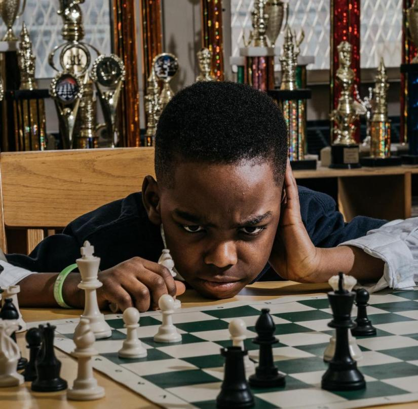 """Tanitoluwa, you are an example of a victorious mind - in chess and in life"".  wrote Bill Clinton about the refugee child Tanitoluwa Adewumi"
