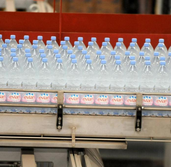 Partial view taken on October 9, 2009 of an assembly line at the Evian mineral water plant in Amphion-Publier, near Evian, French Alps on October 9, 2009. The Evian mineral water belonging to French food giant Danone is the most sold in the world with a daily production of 6 million bottles; sold in 152 countries. AFP PHOTO JEAN-PIERRE CLATOT (Photo credit should read JEAN-PIERRE CLATOT/AFP via Getty Images)