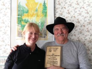 Wenatchee Naturalists, Valerie and Michael Sarratt, honored by Okanogan Conservation District for the conservation practices, post-wildfire.