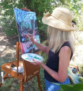Cindy's husband, Bill, captured the artist at work in the out-of-doors studio