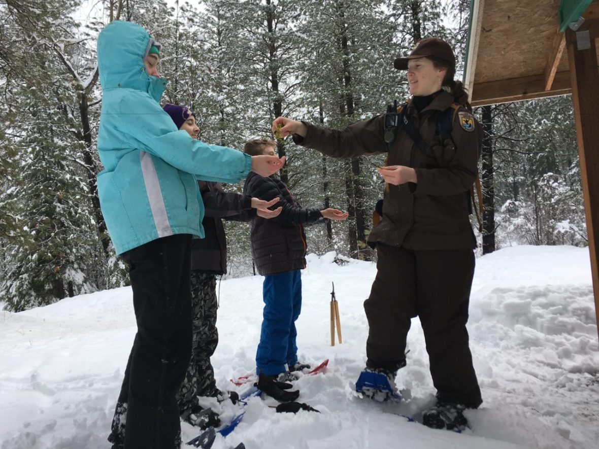 Ranger Marjie Lodwick with students in a snow classroom