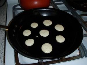 Silver dollar pancakes in the pan
