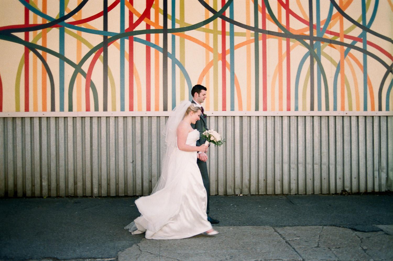 dumbo wedding couple walking by wendy g photography