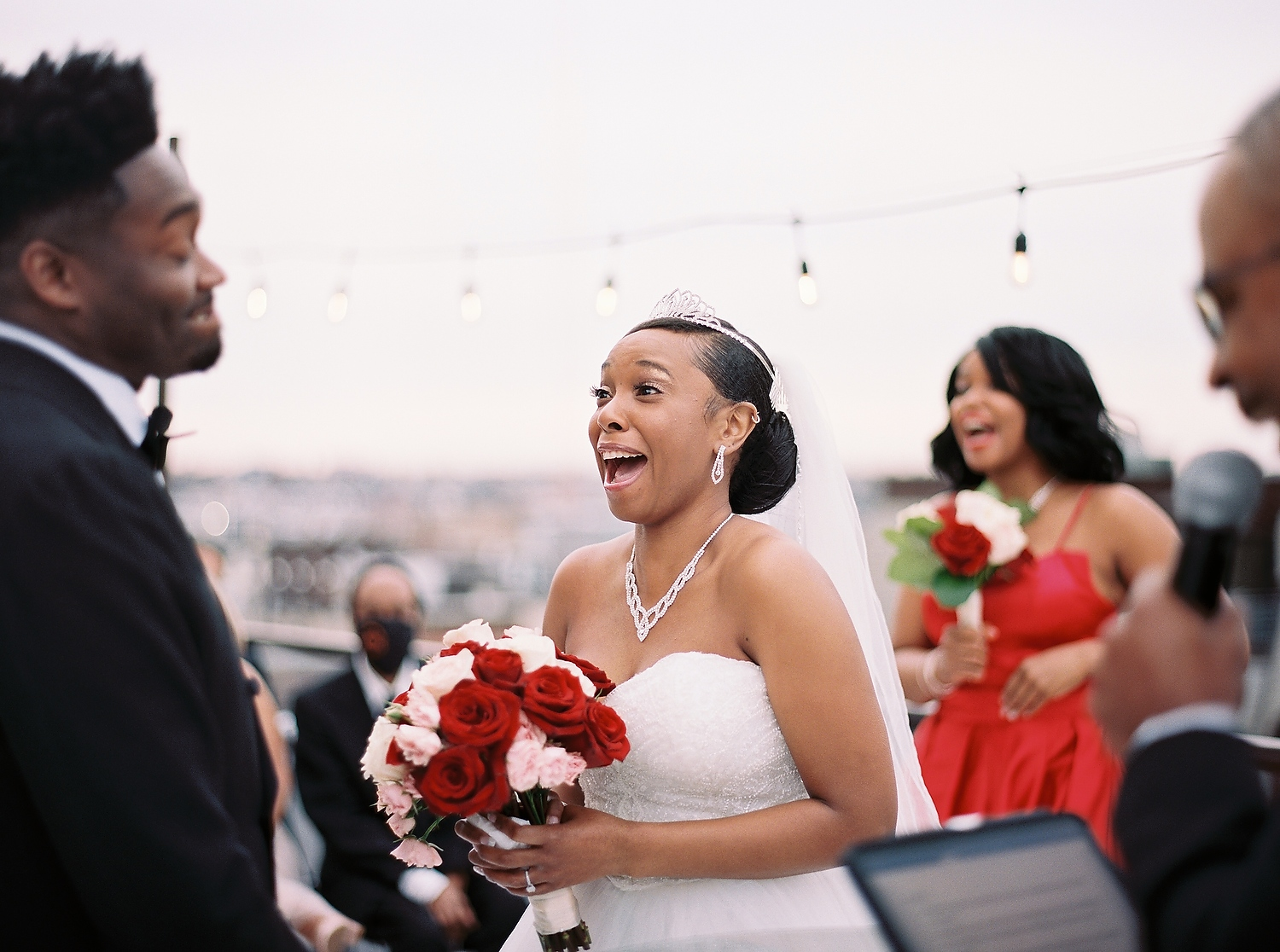 bride laughing during ceremony at Hoboken Loft in NJ taken by nyc wedding photographer wendy g
