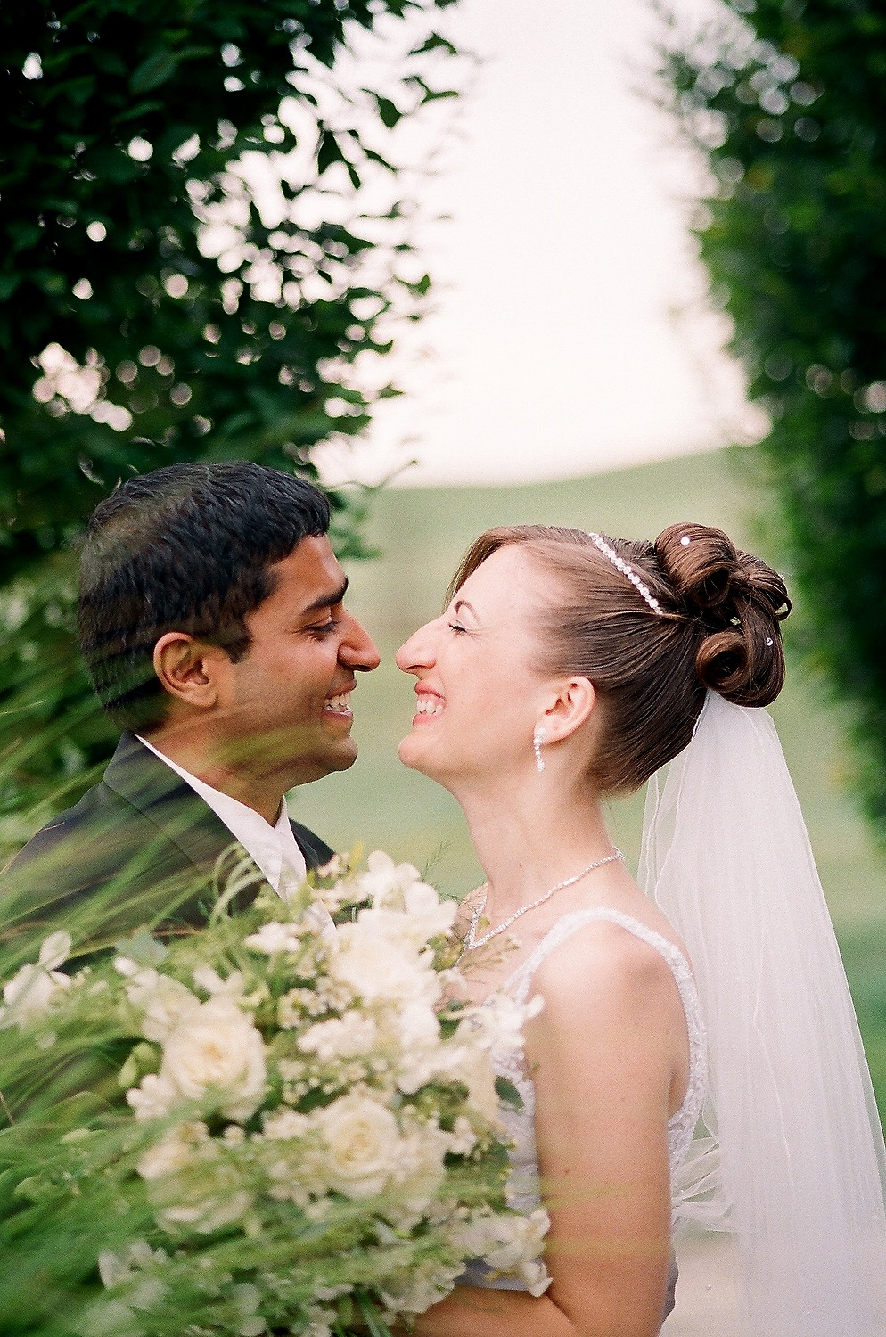 interracial couple laughing in PA taken by nyc wedding photographer wendy g