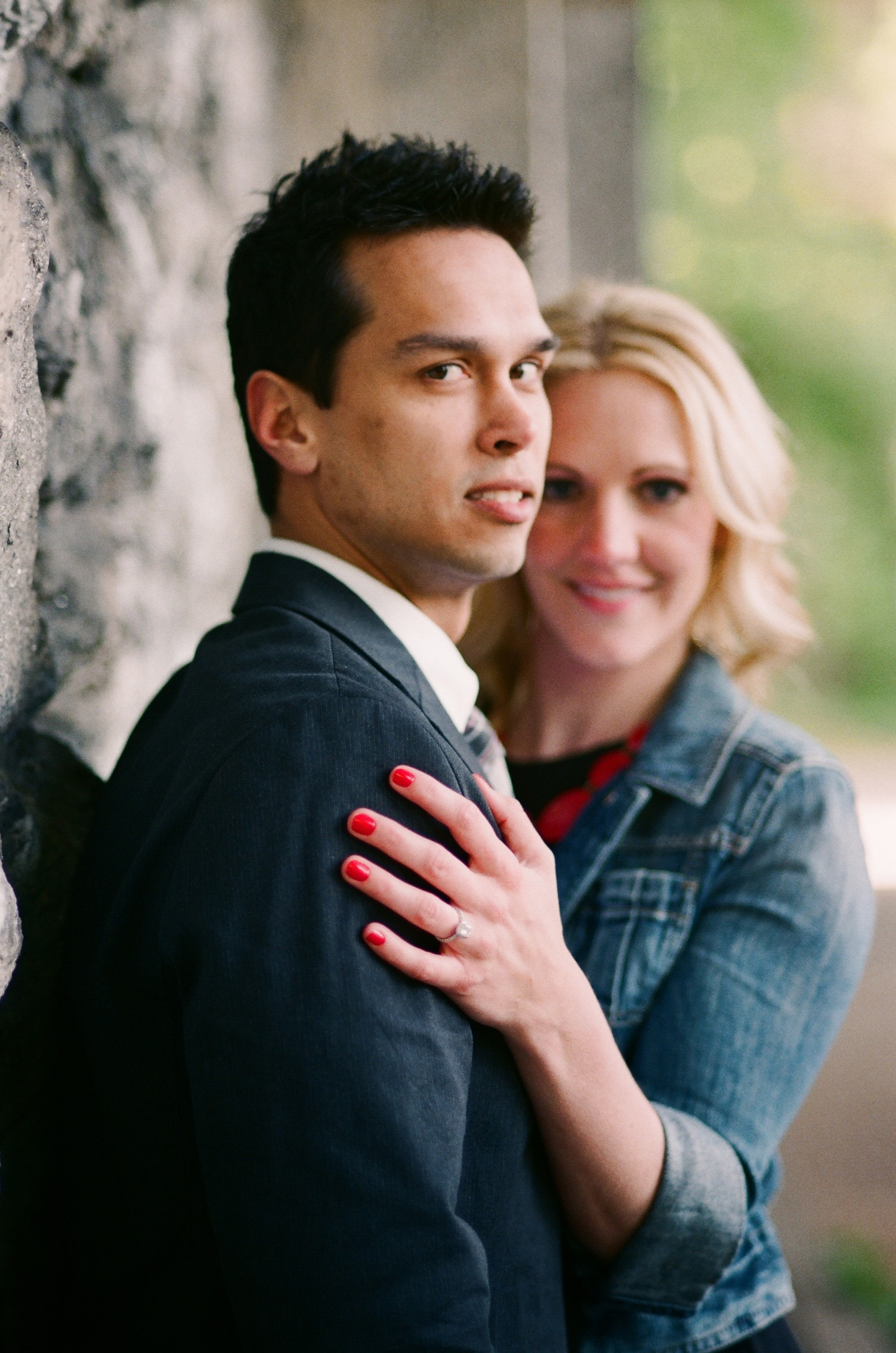 engaged couple looking at camera fort tryon park