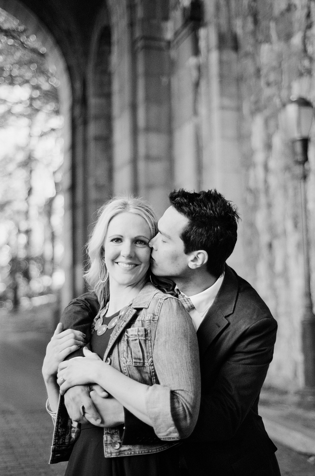 black and white photo of engaged couple laughing fort tryon park wendy g photography