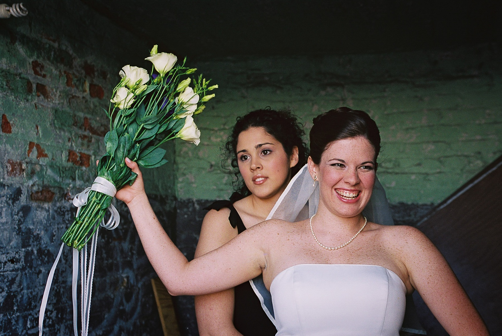 bride holding up bouquet just before entrance