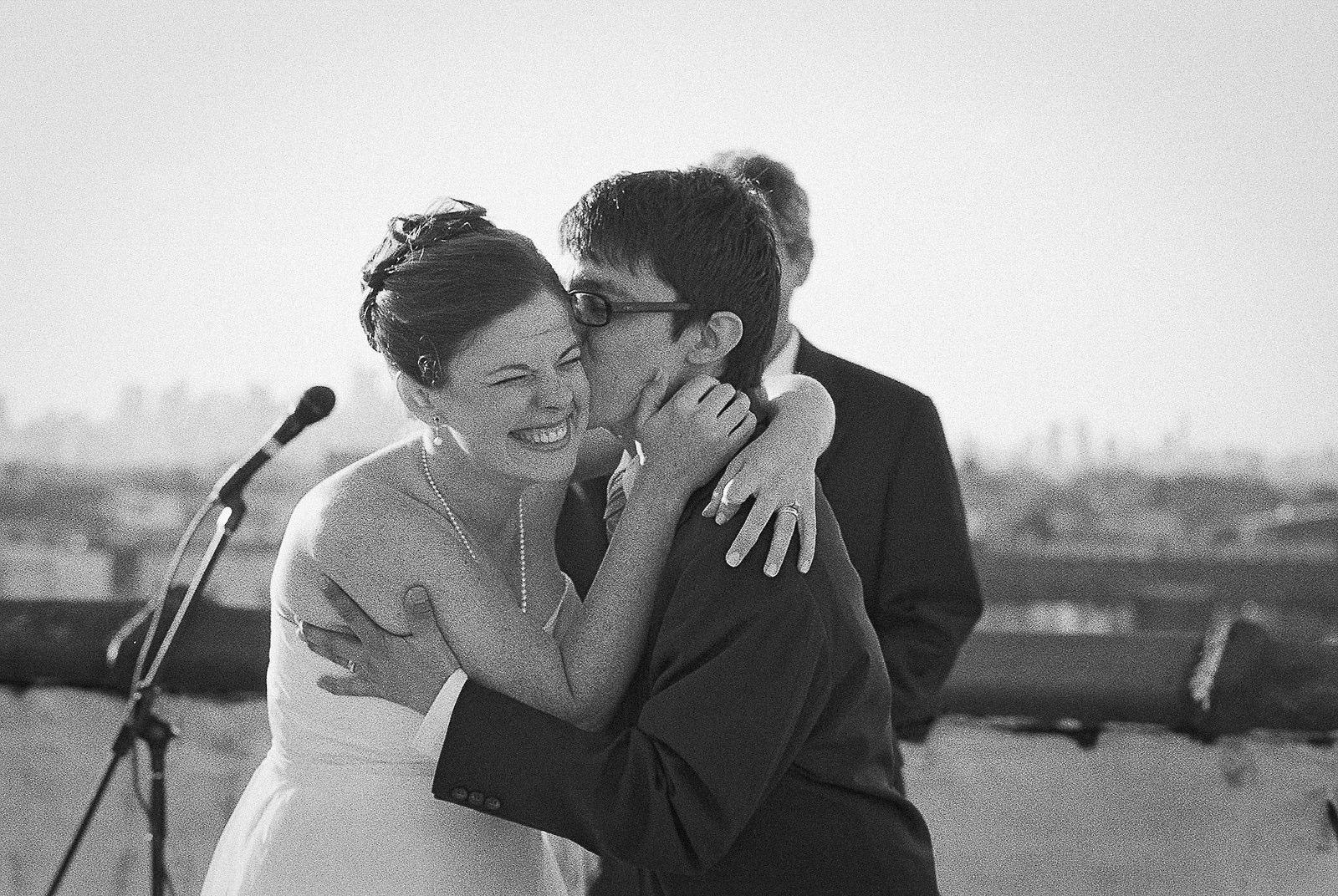 groom kissing bride after ceremony
