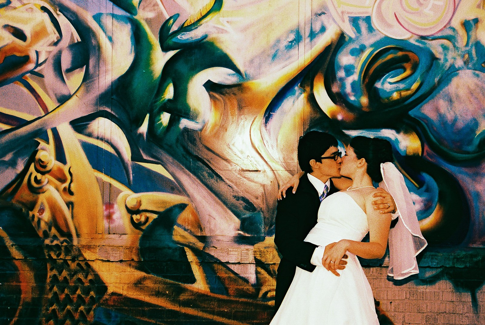 graffiti at office ops brooklyn and couple kissing