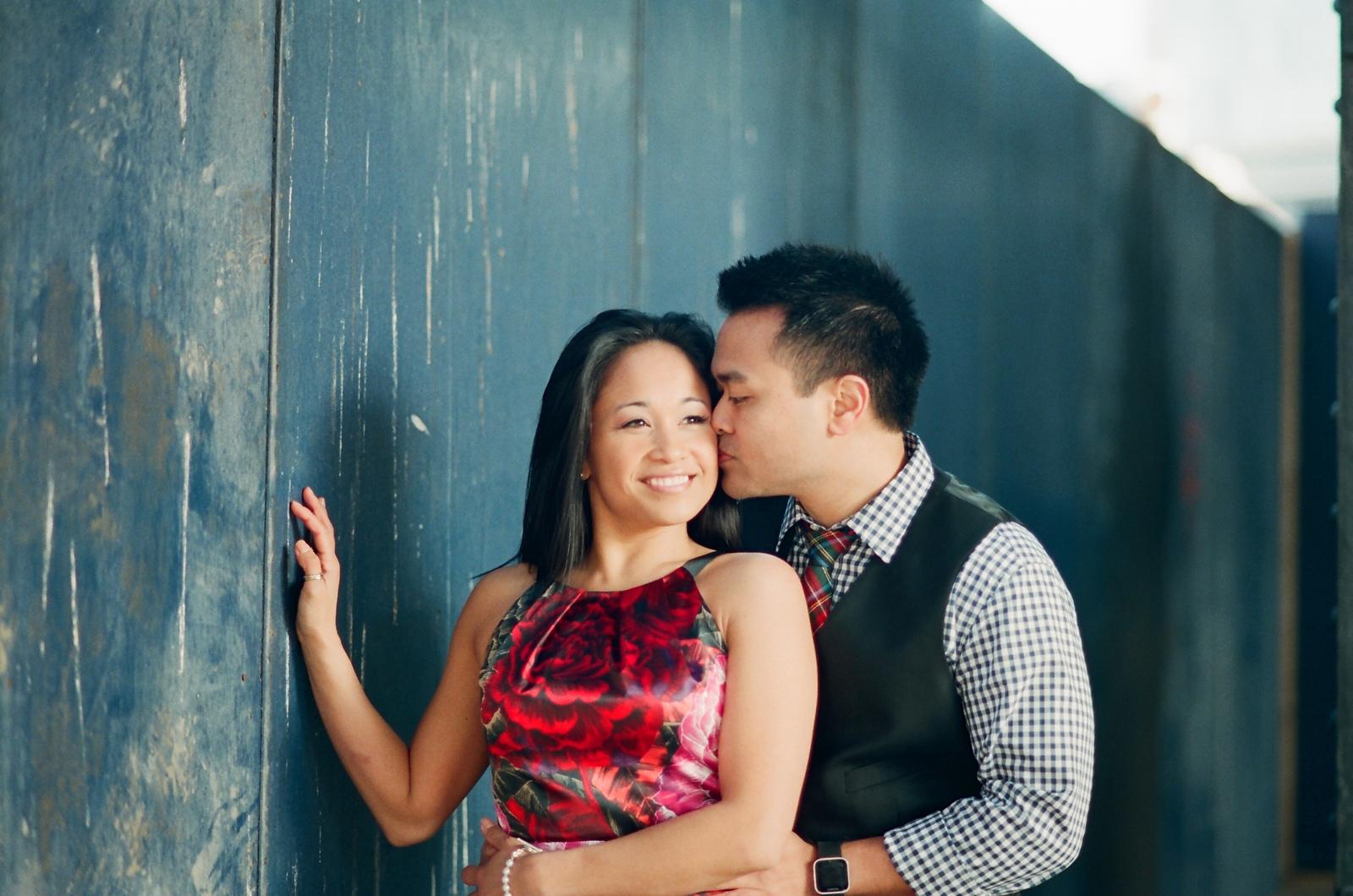 nyc engaged couple groom kissing bride's cheek