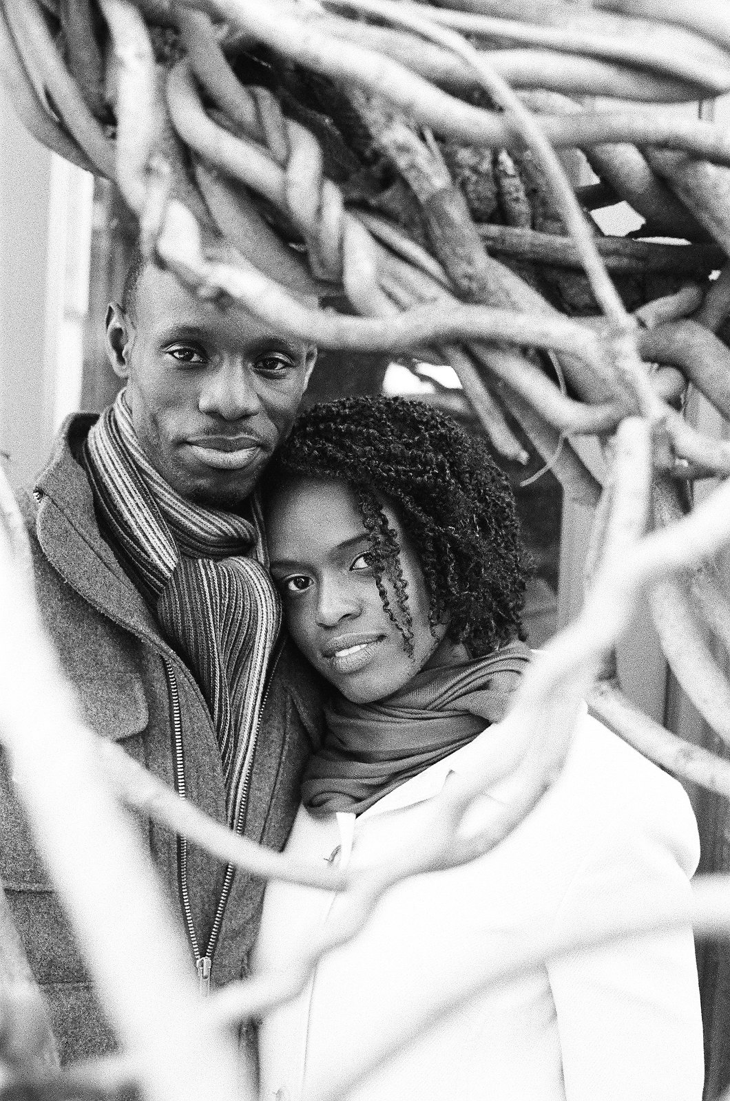 black and white engagement photo couple looking at camera in nyc