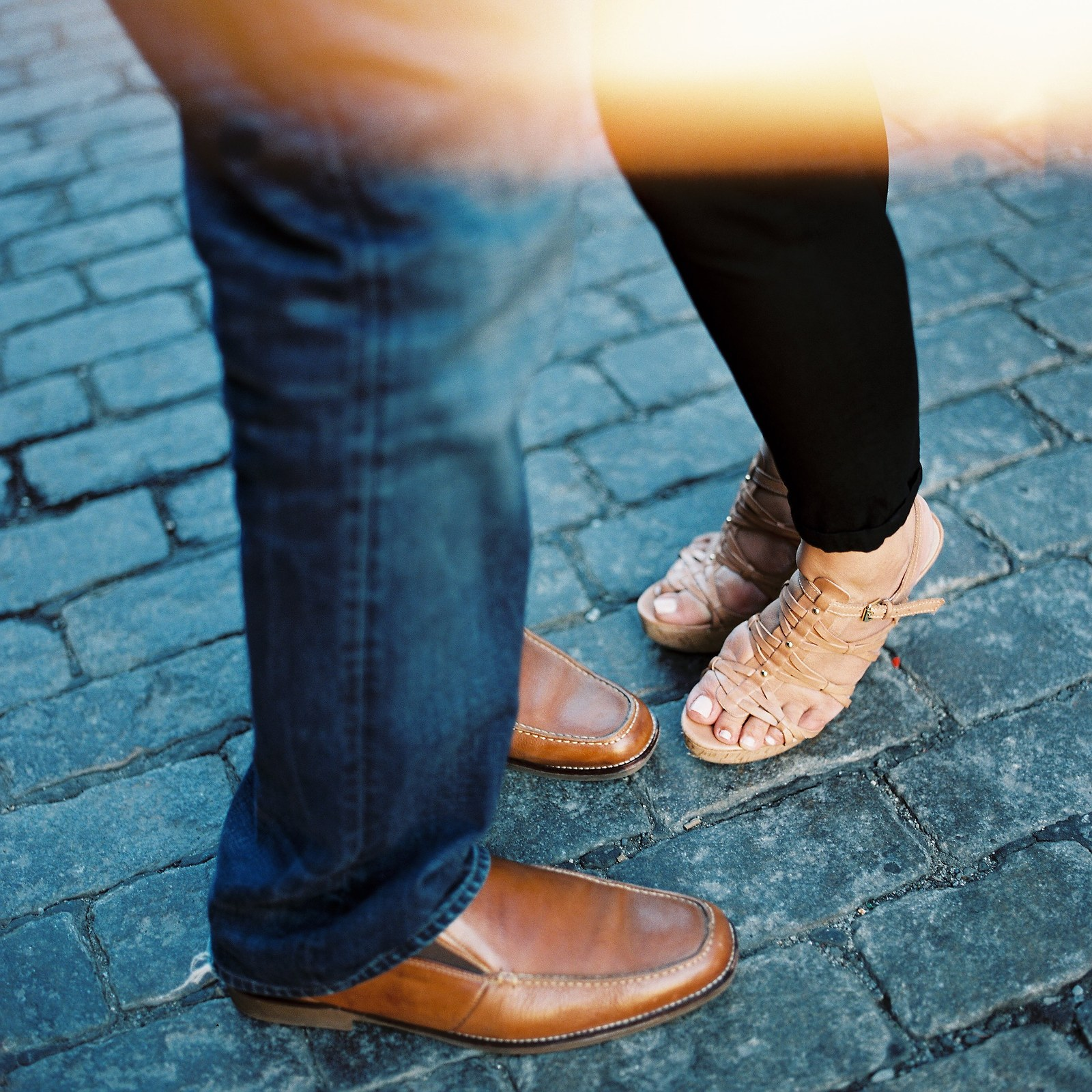 legs and shoes of engaged couple on cobblestone streets in nyc