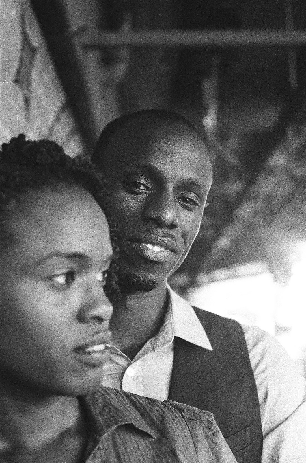 black and white photo of engaged couple's faces groom looking at camera