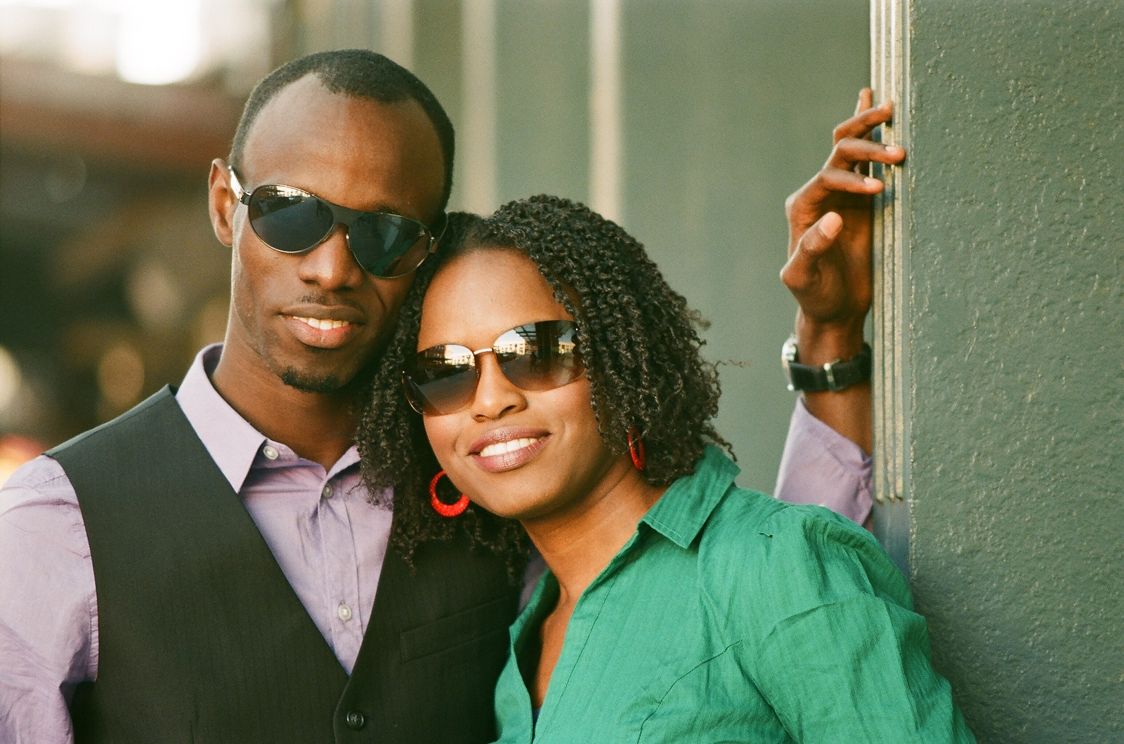 engaged couple wearing sunglasses