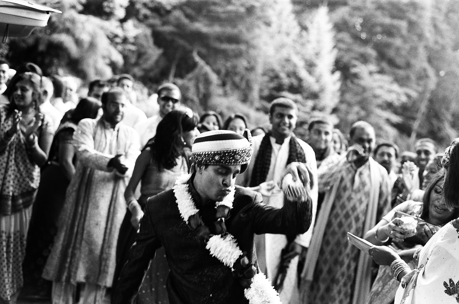 black and white photo of indian groom processional on kodak film