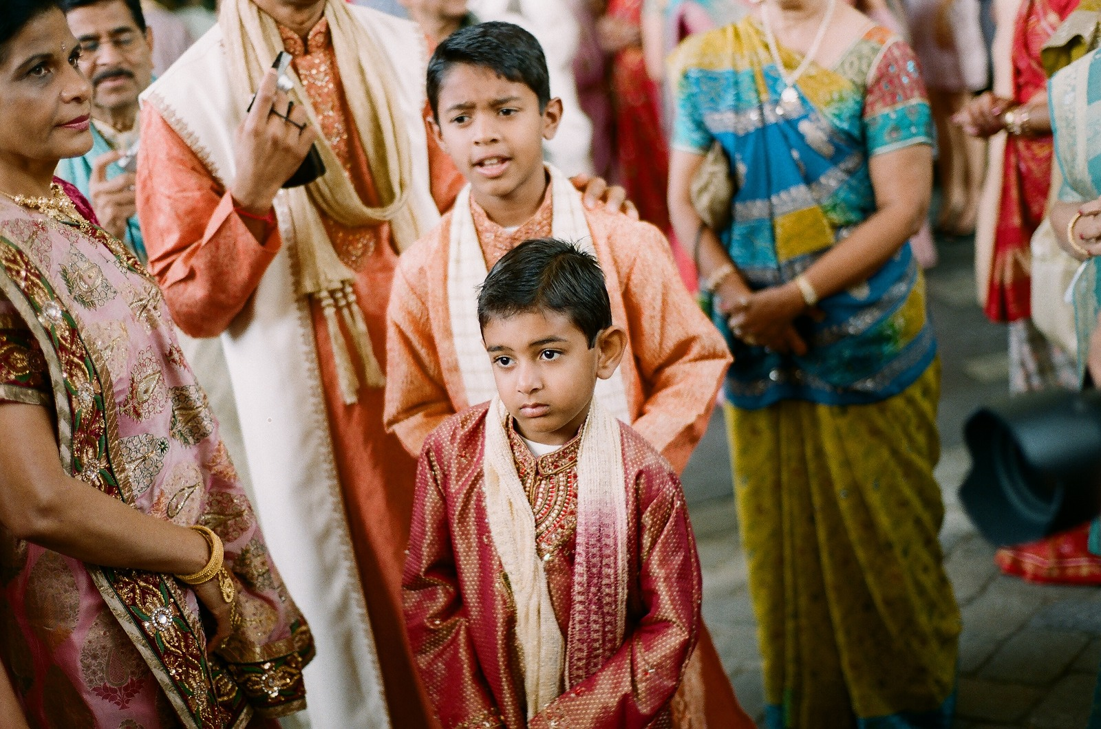 young child watching grooms processional at indian wedding
