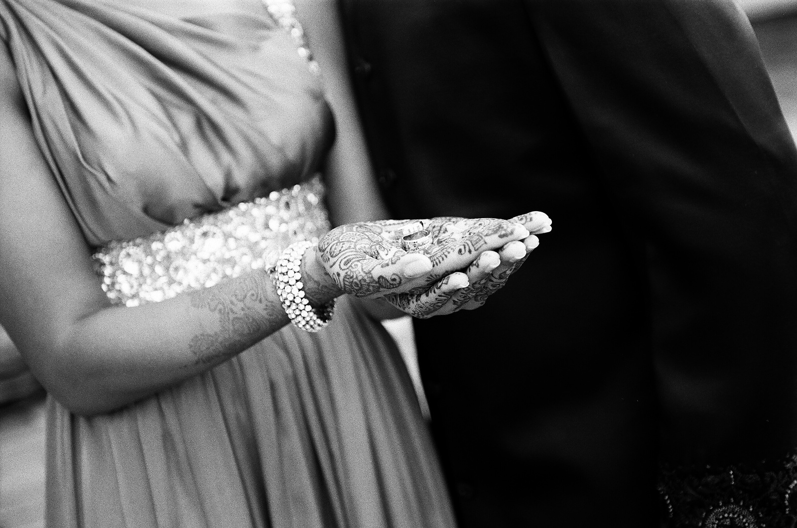 black and white photo of bride holding wedding bands