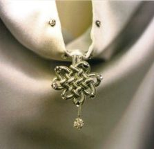 Chinese knotwork creates a focal point at the back of the cloak