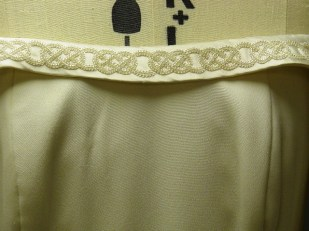 Hand-made Celtic embroidery and beaded knotwork to highlight the neckline of a wedding dress