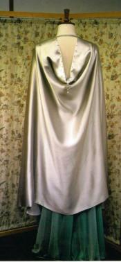 The cloak is cut and made in a way that makes it look like it has a hood at the back.