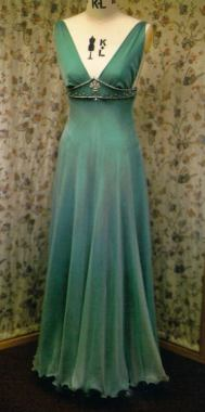 The dress is made from jade green satin with over layer of very pale green chiffon.