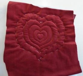 Quilted concentric hearts