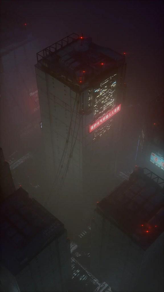 Skyscraper in fog at night