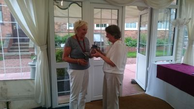 Sybil Taylor receiving the '2016 Golfer of the Tournament' prize from Helen Clare Cromarty