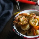 15 minute new orleans bbq shrimp with lemon slices, sliced french bread on cutting board