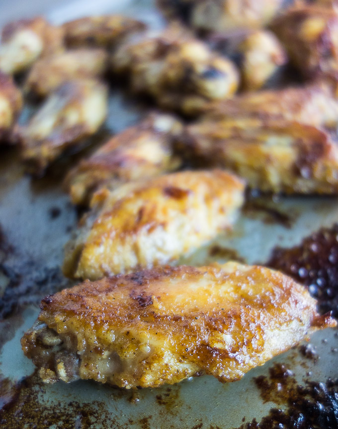 crsipy cajun style chicken wings on a baking sheet