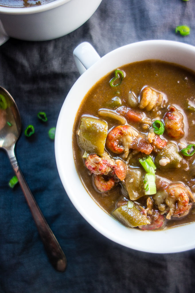 louisiana seafood gumbo with okra, seafood and sausage in roux in a bowl