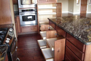 Kitchen cabinet pull out shelves by We Organize-u.com