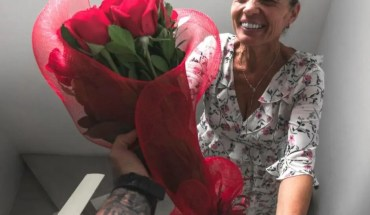 son giving his mom some flowers