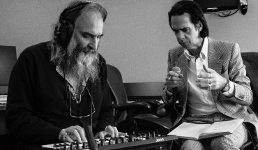 Nick Cave and Warren Ellis working over a lap steel