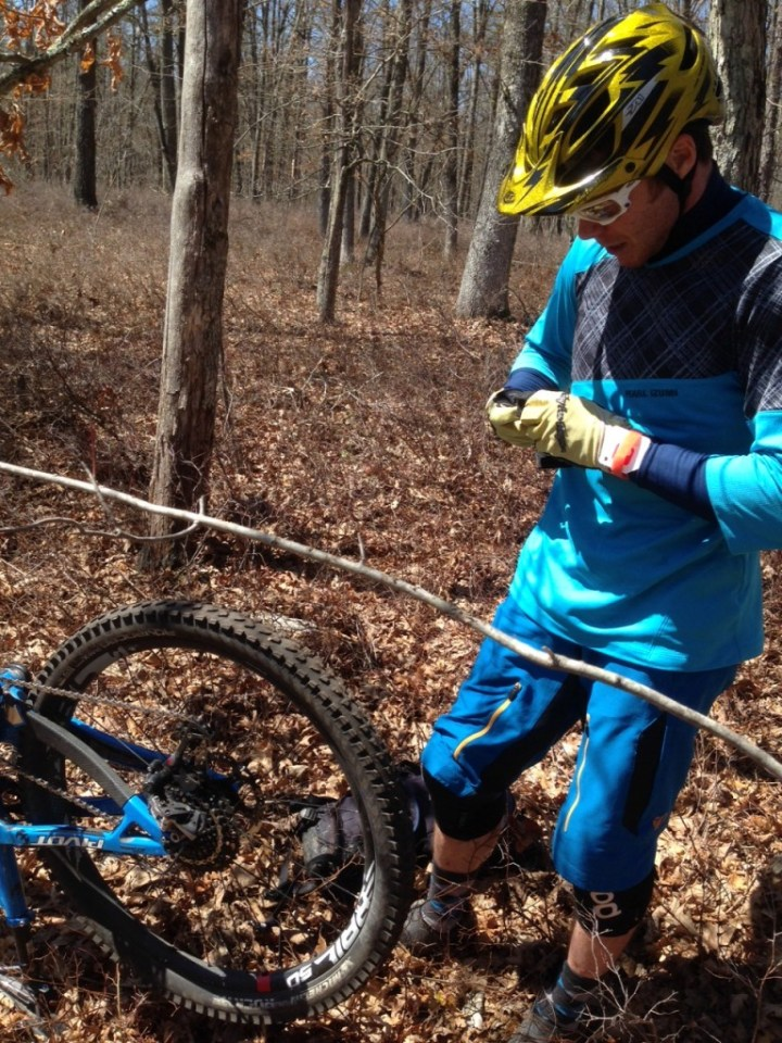 B.J. working on his broken spoke during the Rattling Creek Enduro