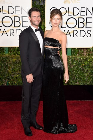 Adam Levine and Behati Prinsloo attends the 72nd annual Golden Globe Awards