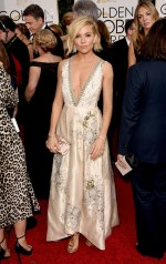 Sienna Miler attends the 72nd annual Golden Globe Awards