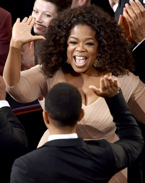 Selma executive producer and actress Oprah Winfrey gave a high-five to John Legend after he and Common took home the Best Original Song Oscar