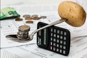 Budgeting with money and a calculator