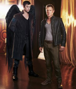 DOMINION -- Season:1 -- Pictured: (l-r) Tom Wisdom as Archangel Michael, Christopher Egan as Alex Lannon -- (Photo by: Gavin Bond/Syfy)