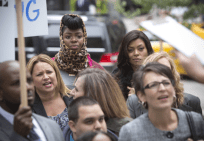"EMPIRE: Porsha (guest star Ta' Rhonda Jones, L) and Cookie (Taraji P. Henson, R) watch a protest in the ""Outspoken King"" episode of EMPIRE airing Monday, Jan. 14 (9:00-10:00 PM ET/PT) on FOX. ©2014 Fox Broadcasting Co. CR: Chuck Hodes/FOX"