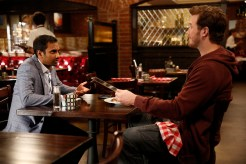 """PARKS AND RECREATION -- """"William Henry Harrison"""" Episode 705 -- Pictured: (l-r) Aziz Ansari as Tom Haverford, Chris Pratt as Andy Dwyer -- (Photo by: Greg Gayne/NBC)"""