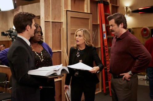 """PARKS AND RECREATION -- """"GryzzlBox"""" Episode 706 -- Pictured: (l-r) Adam Scott as Ben Wyatt, Retta as Donna Meagle, Amy Poehler as Leslie Knope, Nick Offerman as Ron Swanson -- (Photo by: Ben Cohen/NBC)"""